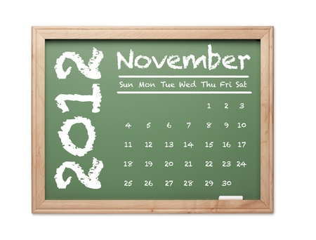 Month of November 2012 Calendar on Green Chalkboard Over White Background. photo