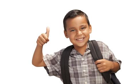 niños latinos: Feliz Joven Escuela Hispano con hasta Pulgares y Mochila Listos para la Escuela Aislado en un fondo blanco.