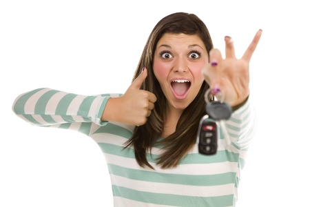 Pretty Ethnic Female with New Car Keys and Thumbs Up Isolated on a White Background. Archivio Fotografico