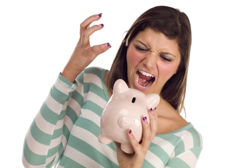 frustration girl: Angry Ethnic Female Yelling At Her Piggy Bank Isolated on a White Background.