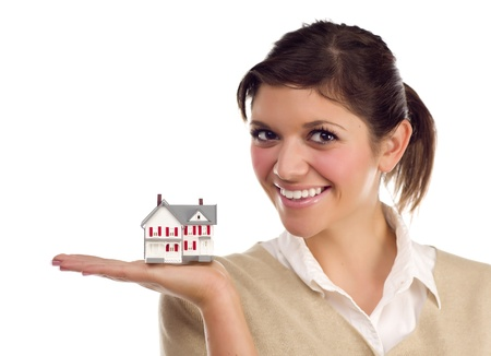 Pretty Smiling Ethnic Female Holding Small House in Hand Isolated on a White Background. photo