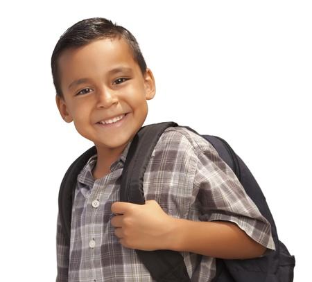 niños latinos: Feliz hispano joven con mochila listo para escuela aislada sobre fondo blanco.