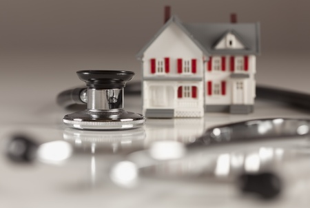 doctor stethoscope: Stethoscope and Model House on Gradated Background with Selective Focus.