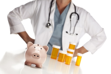 hospital fees: Doctor Wearing Stethoscope Behind Medicine Bottles and Piggy Bank. Stock Photo