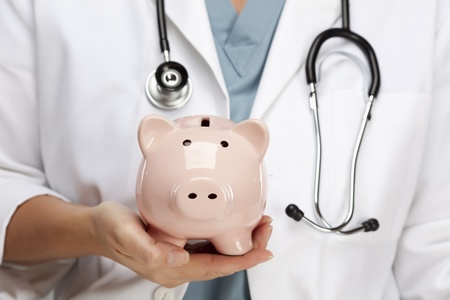 Female Doctor with Stethoscope Holding Piggy Bank Abstract. photo