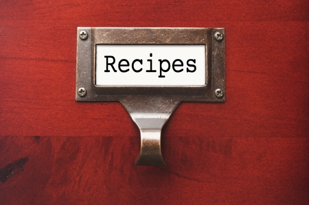 lustrous: Lustrous Wooden Cabinet with Recipes File Label in Dramatic LIght.