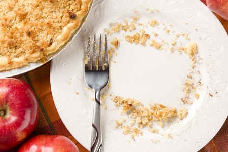 Overhead Abstract of Apples, Pie, Empty Plate with Remaining Crumbs Cleared Into Rectangular Copy Room Space and Fork - Ready for Your Own Message.