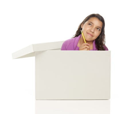 Attractive Young Ethnic Female with Pencil Popping Out and Thinking Outside The Box Isolated on a White Background. photo