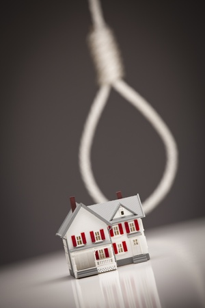 foreclosure: Small House with Hangmans Noose Behind on Grey Background.