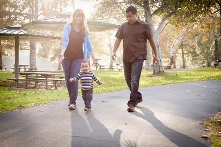 children walking: Happy Young Mixed Race Ethnic Family Walking In The Park. Stock Photo