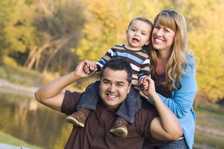 mixed race person: Happy Mixed Race Ethnic Family Posing for A Portrait in the Park. Stock Photo
