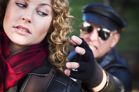 stalking: Pretty Young Teen Girl with Mysterious Strange Man Reaching to Grab Her. Stock Photo