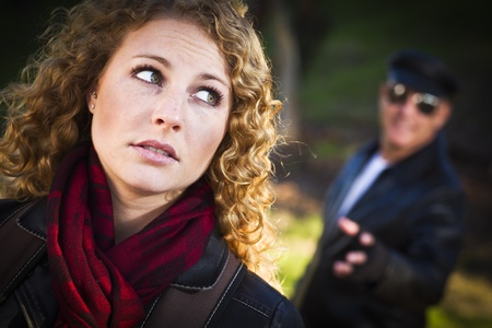 Pretty Young Teen Girl with Mysteus Strange Man Lurking Behind Her. Stock Photo - 11396046