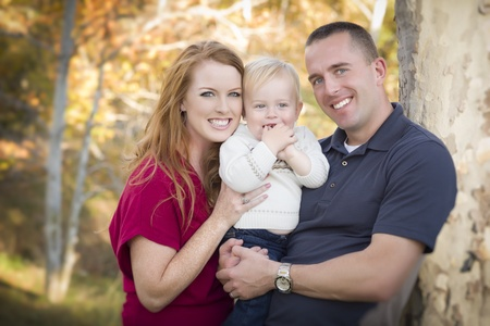 Young Attractive Parents and Child Portrait Outdoors. photo