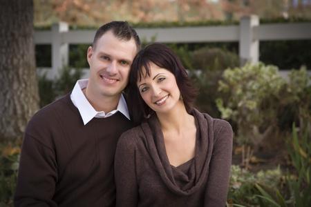 Attractive Couple Portrait in the Park. photo