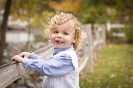 blonde boy: Happy Adorable Young Blonde Boy Playing Outside. Stock Photo