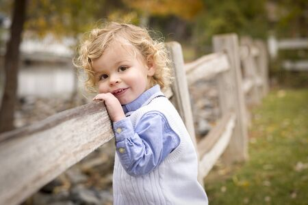 Happy Adorable Young Blonde Boy Playing Outside. photo