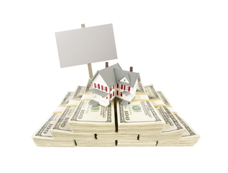 in escrow: Small House on Stacks of Hundred Dollar Bills and Blank Sign Isolated on a White Background.