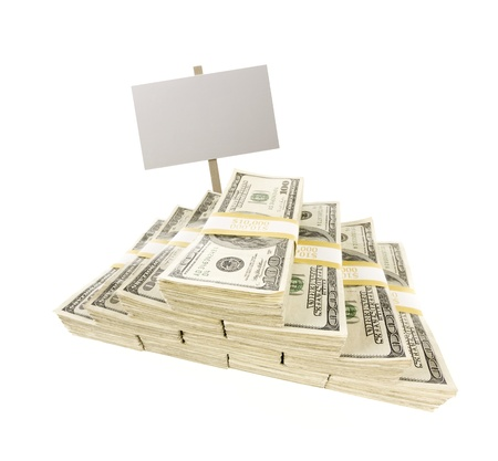 Stacks of One Hundred Dollar Bills with Blank Sign Isolated on a White Background.