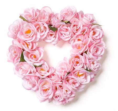Heart Shaped Pink Rose Arrangement on a White Background. photo