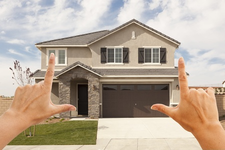 constructed: Female Hands Framing Beautiful Newly Constructed House. Stock Photo