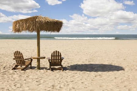 Two Beach Chairs and Umbrella on a Beautiful Ocean Front with Copy Space. photo