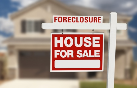 Foreclosure House For Sale Sign in Front of Beautiful Home. Stock Photo
