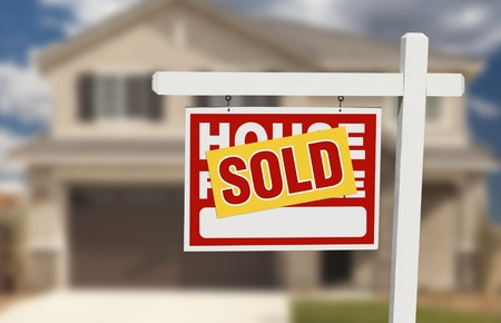 real estate sold: Sold Home For Sale Sign in Front of Beautiful New House. Stock Photo