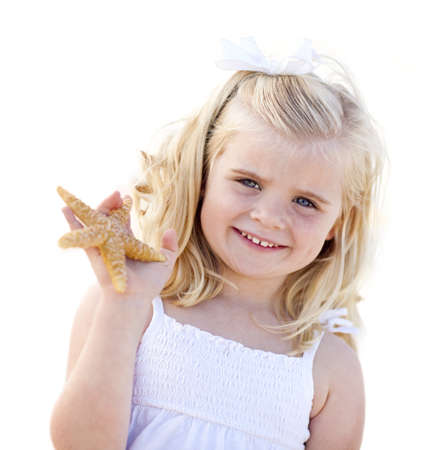 Adorable Little Blonde Girl with Starfish Isolated on a White Background. photo
