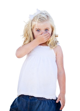 hand over: Adorable Blue Eyed Girl Covering Her Mouth Isolated on a White Background.