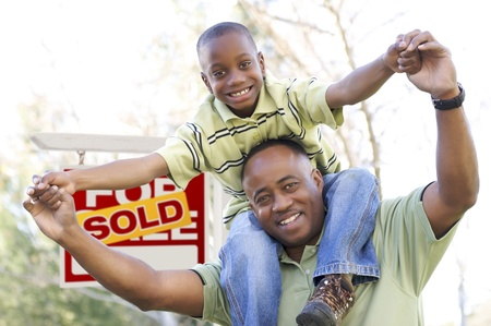 for kids: Happy African American Father and Son in Front of Sold Real Estate Sign.