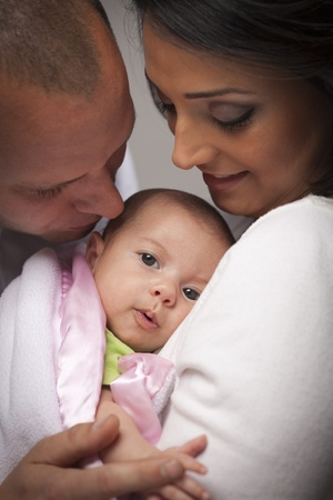Happy Young Attractive Mixed Race Family with Newborn Baby. Stock Photo - 13030831