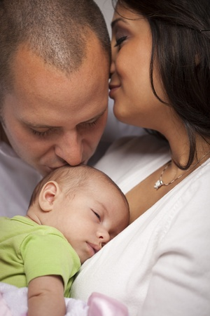 Happy Young Attractive Mixed Race Family with Newborn Baby.