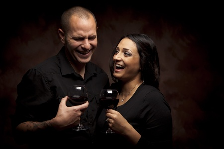 Happy Young Mixed Race Couple Holding Wine Glasses Against A Black Background. Stock Photo - 13237480