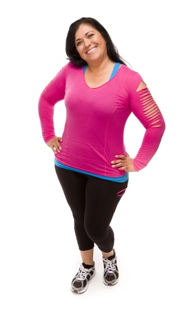 Attractive Middle Aged Hispanic Woman In Workout Clothes Against a White Background.