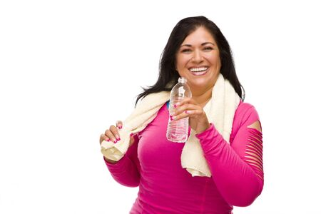 Attractive Middle Aged Hispanic Woman In Workout Clothes with Water Bottle and Towel Against a White Background. photo