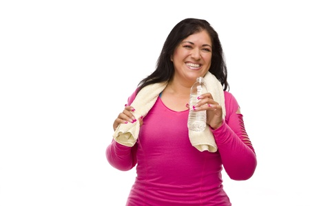 aged: Attractive Middle Aged Hispanic Woman In Workout Clothes with Water Bottle and Towel Against a White Background. Stock Photo