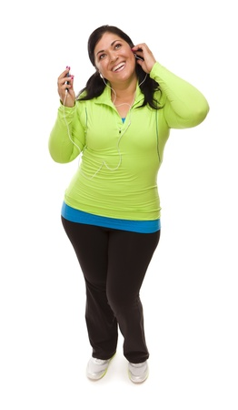Attractive Middle Aged Hispanic Woman In Workout Clothes with Music Player and Headphones Against a White Background. photo