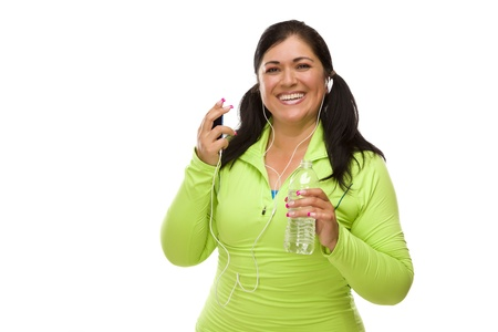 Attractive Middle Aged Hispanic Woman In Workout Clothes with Music Player, Headphones and Water Against a White Background. photo