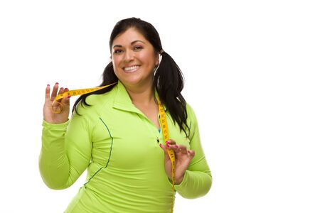 Attractive Middle Aged Hispanic Woman In Workout Clothes Showing off Her Tape Measure Against a White Background. Stock Photo - 13397866