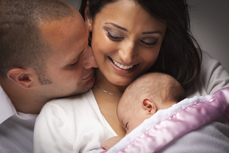 multiracial family: Happy Young Attractive Mixed Race Family with Newborn Baby.