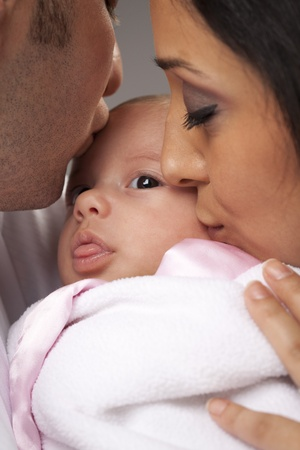 mixed race baby: Happy Young Attractive Mixed Race Family with Newborn Baby.