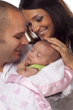 multiracial family: Happy Young Attractive Mixed Race Couple with Newborn Baby.