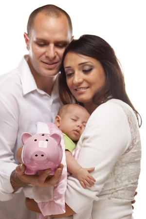 minority couple: Attractive Young Mixed Race Parents with Baby Holding Piggy Bank on a White Background.