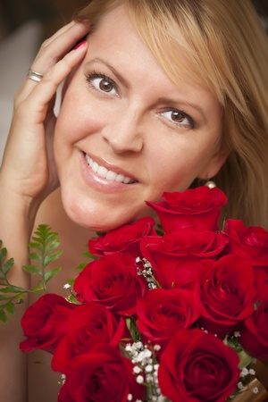 Beautiful Smiling Blonde Woman with Red Roses. photo