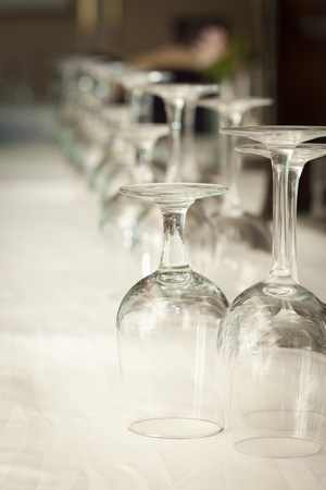 Several Drinking Glasses Abstract in Formal Dining Room Setting. photo
