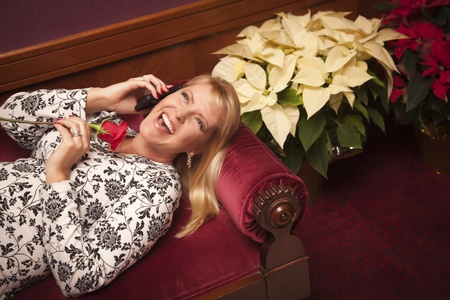 Beautiful Laughing Blonde Woman on Purple Chair Using Cell Phone. Stock Photo - 13592048
