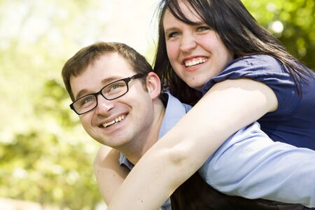 Attractive Young Couple Having Fun Outside in the Park photo