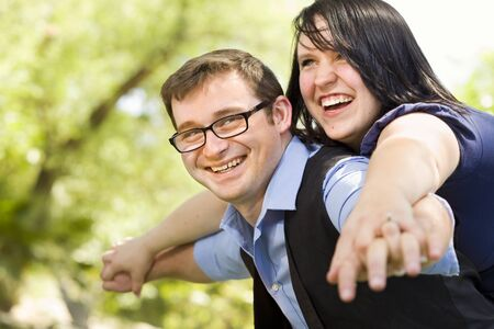 Attractive Young Couple Having Fun Outside in the Park Stok Fotoğraf