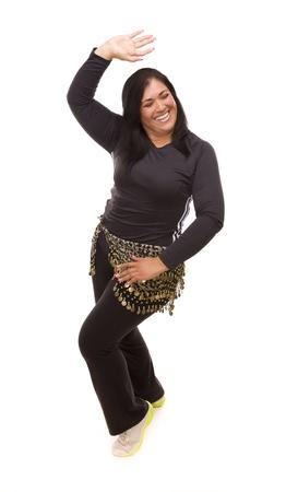 Attractive Hispanic Woman Dancing Zumba on a White Background  photo